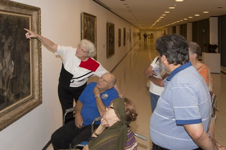 Veterans on a tour of the museum discussing Pablo Picasso's Nude Figure